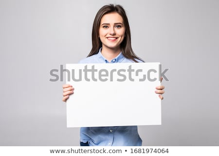 attractive smiling woman holding white empty paper isolated on white stock photo © artjazz