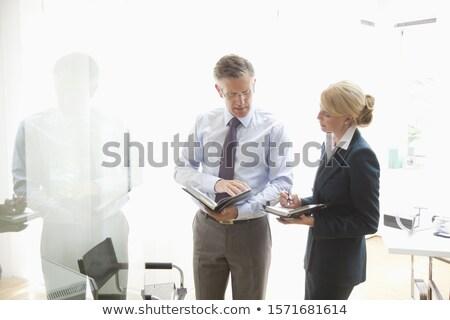 Empresário secretário olhando diário escritório jovem Foto stock © wavebreak_media