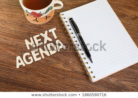 Réaction note l'ordre du jour stylo bureau papier Photo stock © fuzzbones0