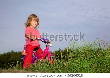 young curly girl biker rests in the field stock photo © paha_l