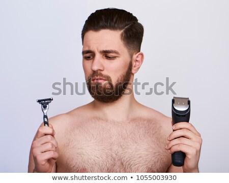 Jóképű fiatalember választ borotva szürke izolált Stock fotó © deandrobot