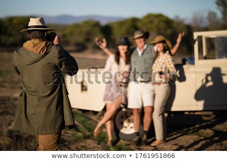 Man taking a picture of his friends during safari vacation Stock photo © wavebreak_media