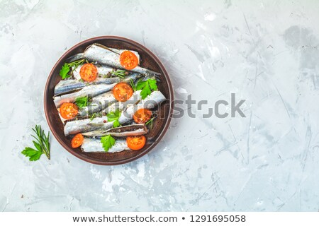Raw uncooked sea fish, top view, copy space for you text, flat l Stock photo © artsvitlyna