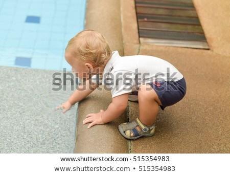 Boy todler touch the water Stock photo © galitskaya