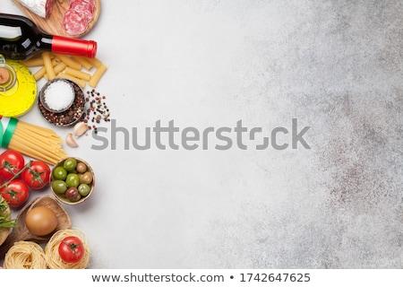 Cozinha italiana comida ingredientes macarrão queijo salame Foto stock © karandaev