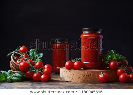 red tomatoes in a glass jar stock photo © angelp