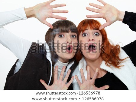 Two friends pressing their face on a pane. Stock photo © photography33