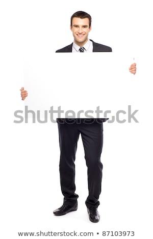 Happy Businessman Holding Blank Billboard stock photo © AndreyPopov