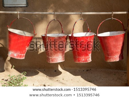 bucket with sand in a petrol station for fire fighting  Stock photo © meinzahn