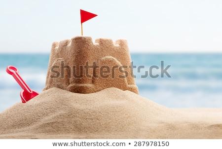 Homokvár tengerparti homok kastély kicsi zászlók Európa Stock fotó © ivonnewierink
