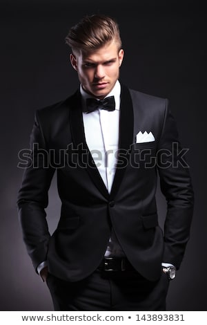 business man holding both hands to his neck. Stock photo © feedough