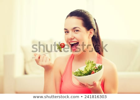 Mangiare sano ciotola insalata ragazza teen Foto d'archivio © HighwayStarz
