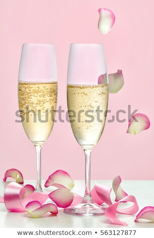 two champagne glasses and pink rose flower stock photo © karandaev