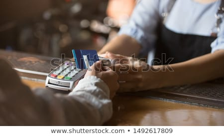 close up of woman hands holding restaurant bill stock photo © dolgachov
