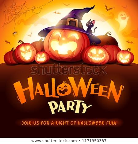 happy halloween title and witch hat pumpkin lantern stock photo © tasipas