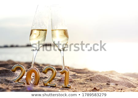 Stock photo: Two champagne glasses against New Year