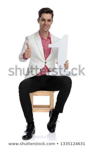 man holding a number one letter makes the ok sign stock photo © feedough