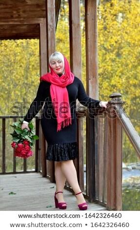 dalgın · sarışın · kadın · güller · yalıtılmış · siyah - stok fotoğraf © pekour