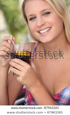 Teenage girl drinking a glass of fruit punch in the sunshine Stock photo © photography33