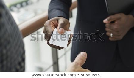 üzletember · névjegy · potenciál · ügyfél · kezek · telefon - stock fotó © photography33