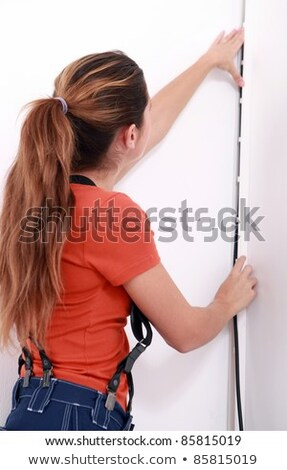 Woman in dungarees installing cable Stock photo © photography33