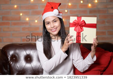 santa claus girl showing gift box stock photo © carlodapino