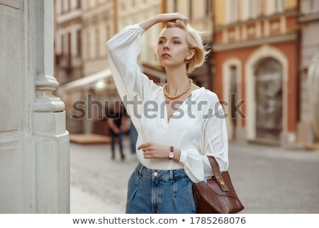 woman white dressed with necklaces Stock photo © imarin