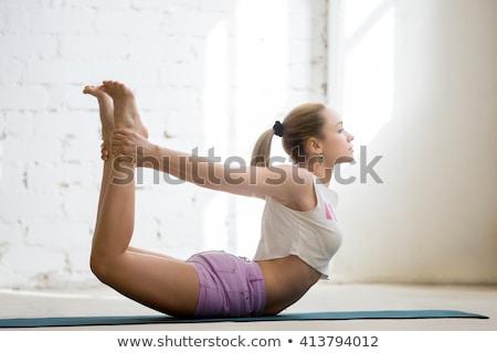 Girl doing upward bow yoga pose Stock photo © wavebreak_media