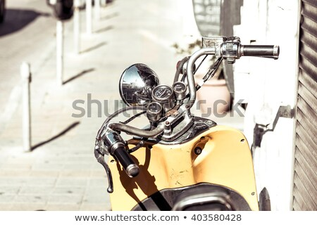close up photo of retro scooter in the city stock photo © kirill_m
