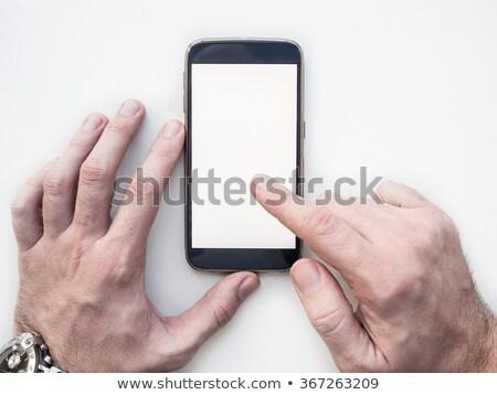 közelkép · mobil · okostelefon · felfelé · fehér · képernyő - stock fotó © Customdesigner