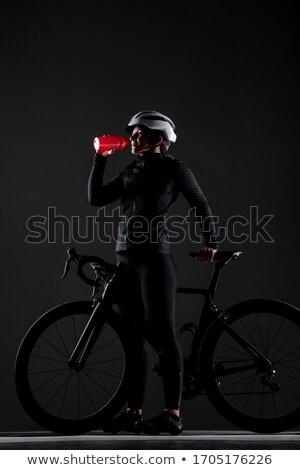 Vrouwelijke fietser drinkwater platteland technologie Stockfoto © wavebreak_media