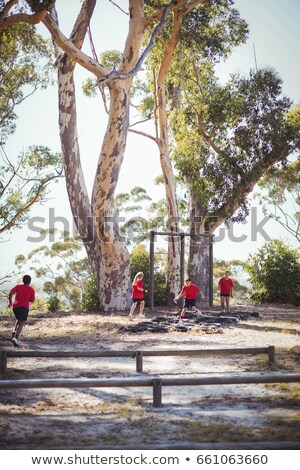 Kid jumping over the hurdles during obstacle course training Stock photo © wavebreak_media