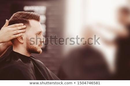 Człowiek dotknąć podbródek podpisania Zdjęcia stock © wavebreak_media