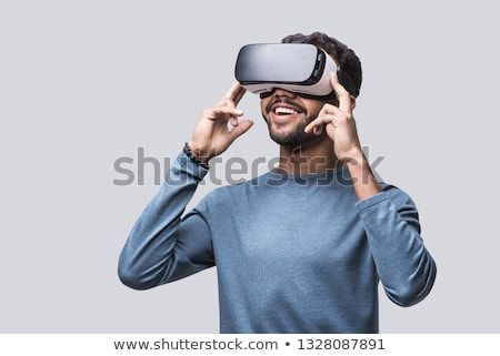 Uomo virtuale video occhiali bianco divertimento Foto d'archivio © wavebreak_media