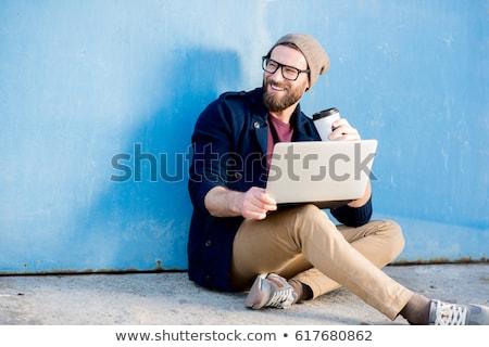 Retrato sonriendo hombre suéter bufanda pie Foto stock © deandrobot
