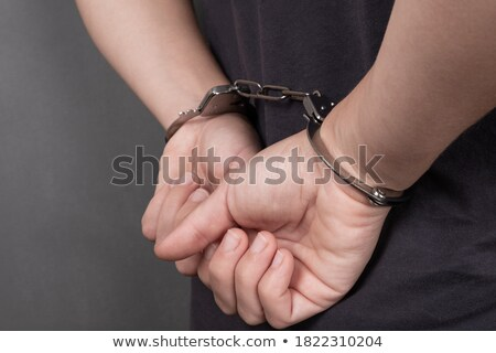 Dark backgrounded close handcuffed man Stock photo © ra2studio