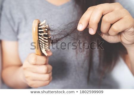 Hair fall and comb Stock photo © szefei