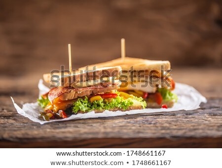 Food on table. Bacon, cheese, bread on a plate with healthy vegetables. Coffee on the table next to  Stock photo © makyzz