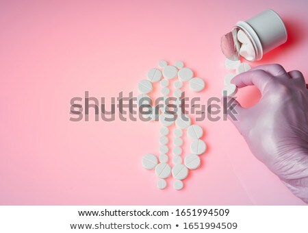 Sign Of Dollar Made Up Out Of White Tablets Stock photo © AndreyPopov