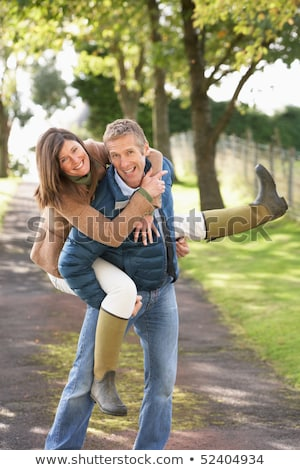 Couple Having Fun Whilst Walking In Autumn Park stock photo © monkey_business