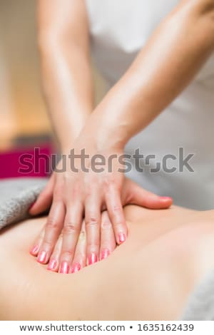 Woman having an professional massage of the abdomen Stock photo © boggy