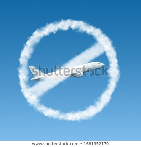Warning sign from clouds with crossed out plane. Stock photo © artjazz