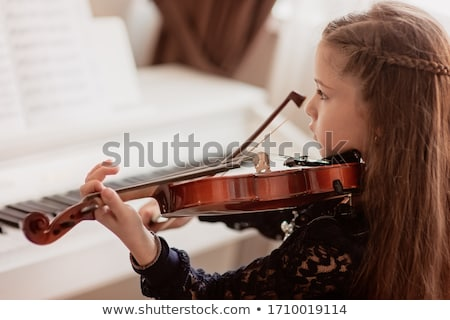 Girl playing violin Stock photo © jossdiim