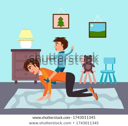 Father playing with son at home, man riding kid at back like horse, family spending time together Stock photo © robuart