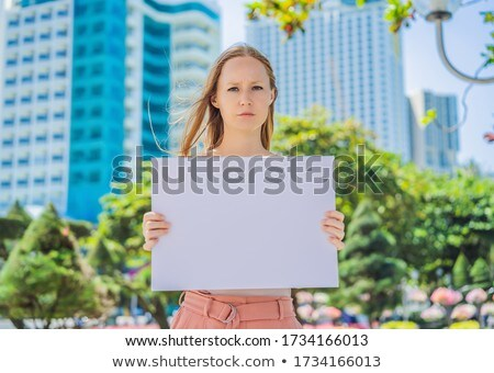 Woman holds a poster free for inscriptions in the city Stock photo © galitskaya