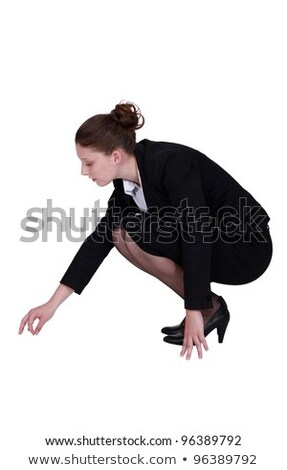 Businesswoman picking a speck up off the floor Stock photo © photography33