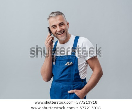 man in dungarees on the phone Stock photo © photography33