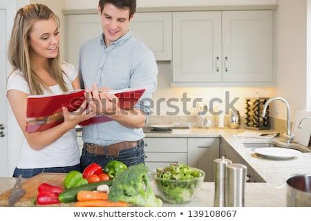 Couple following a recipe book Stock photo © photography33
