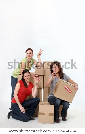 trio of female students moving in together Stock photo © photography33