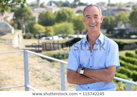 Senior man leaning against railing Stock photo © photography33